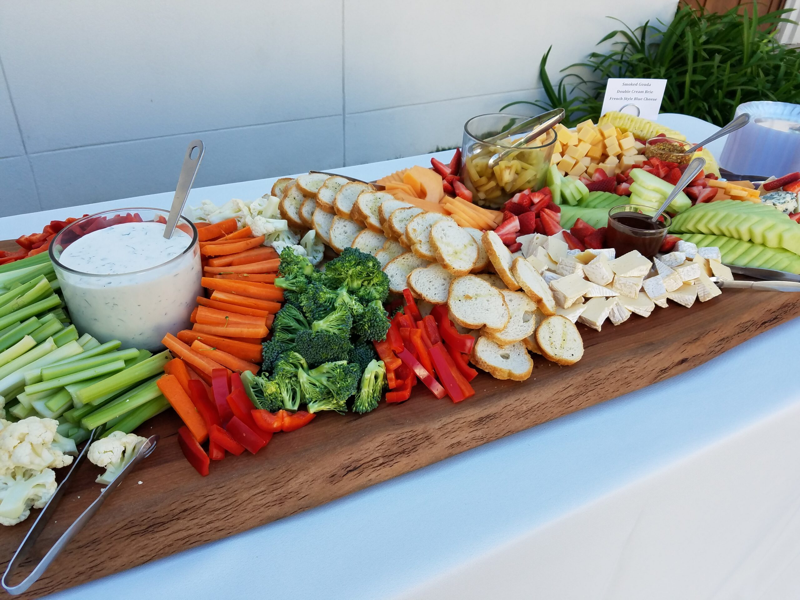 Fresh and vibrant fruit and crudites grazing table board.