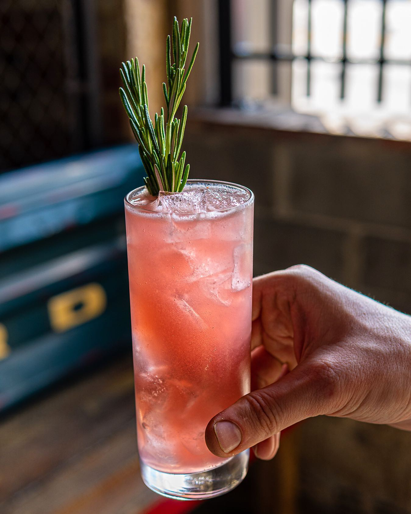 Pink drink and rosemary